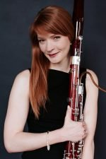 Photo of Dr. Laura Bennett Cameron with bassoon